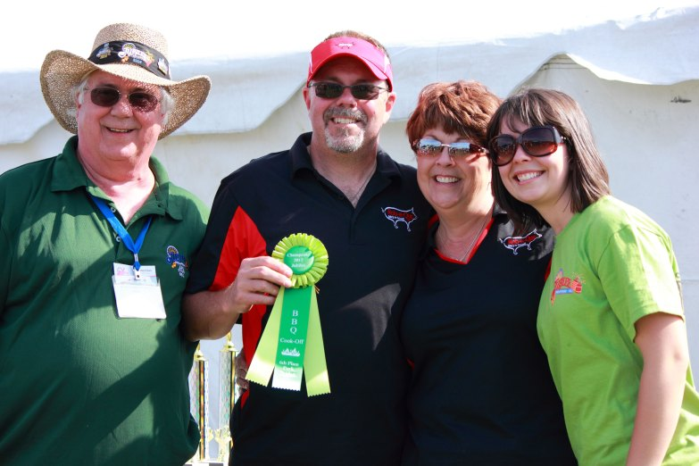 The Rob-a-Que team accepting their 6th place ribbon in the Pulled Pork category.