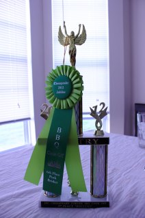 Rob-a-Que's 5th place trophy for Chicken and their 6th place ribbon for Pulled Pork.